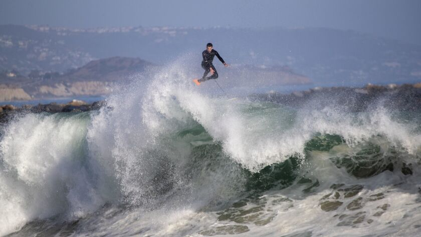 A body boarder soars without his board over a wave in Newport Beach on Monday. Large waves and strong rip currents continue through Tuesday at south-facing beaches.