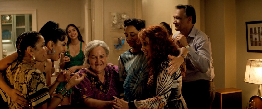 """A house party — with Abuela Claudia in the center — gets under way in """"In the Heights."""""""
