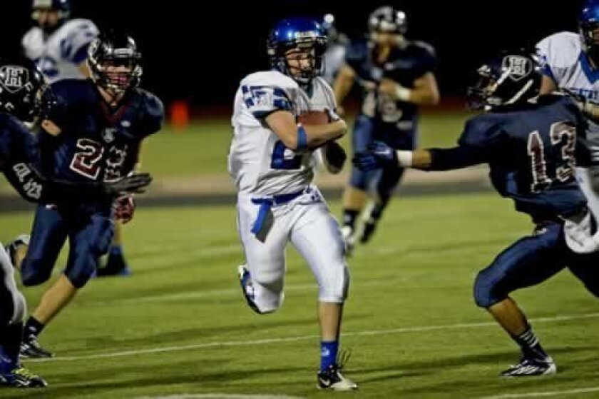 A La Jolla Country Day School runner breaks off for a big gain. (Photo by Andy Hayt)