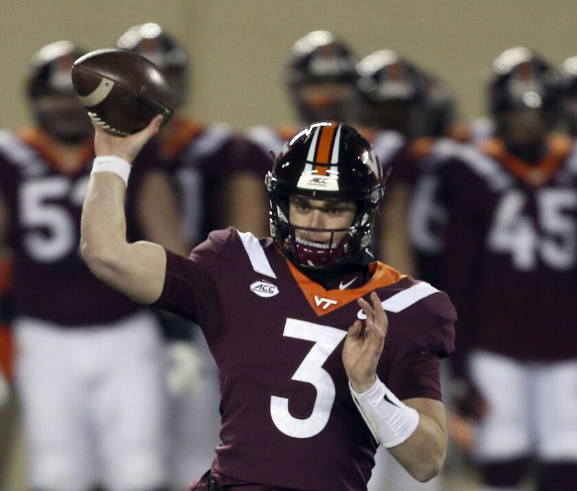 FILE - Virginia Tech quarterback Braxton Burmeister throws a pass during the first half against Clemson in an NCAA college football game in Blacksburg, Va., in this Saturday, Dec. 5, 2020, file photo. Few Power Five programs struggled through the pandemic more than Virginia Tech. Coach Justin Fuente and the Hokies hope to restore some order this season. (Matt Gentry/The Roanoke Times via AP, Pool, File)