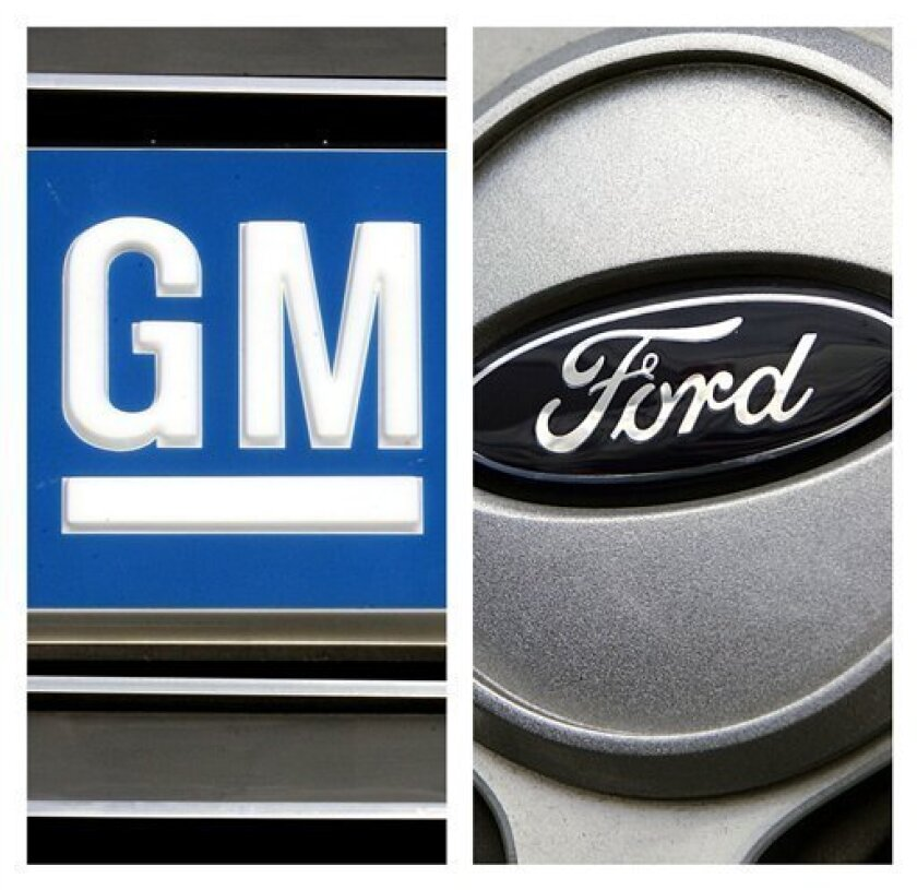 FILE - In this combo made with file photos, logos for General Motors and Ford are shown. If investors pay what General Motors hopes to get for its stock in a planned IPO, they'll have to buy the logic that the company's stock-market value should be similar to its closest competitor, Ford Motor Co. But Ford is making far more money these days and its U.S. market share is rising while GM's is falling and its new management team has little auto industry experience. (AP File Photos)