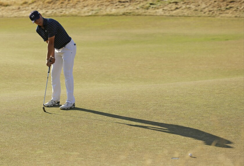 Jordan Spieth misses a putt for eagle on the 18th hole during the final round of the 115th U.S. Open at Chambers Bay in Univeristy Place, Wash.