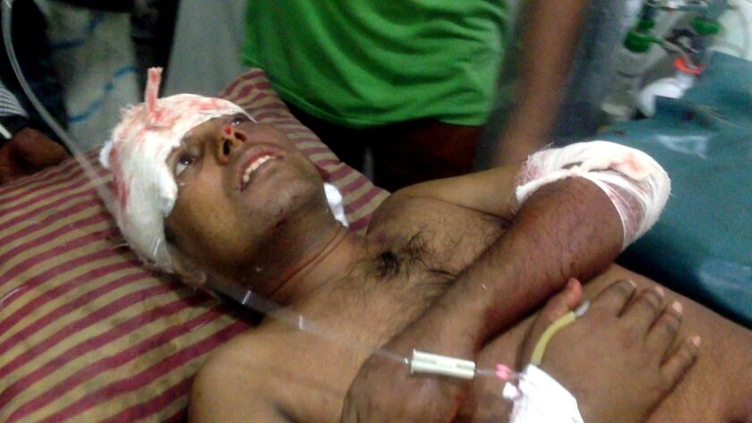 Ripon Chakroborty, a Hindu mathematics lecturer, is taken to the hospital after he was attacked by three men in his house in Madaripur, Bangladesh on June 15.