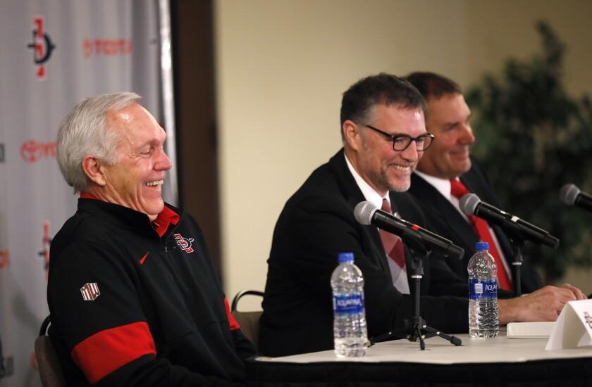 Brady Hoke, far right, is returning as Aztecs football coach as Rocky Long, left, announced he is stepping away. At center: AD John David Wicker.