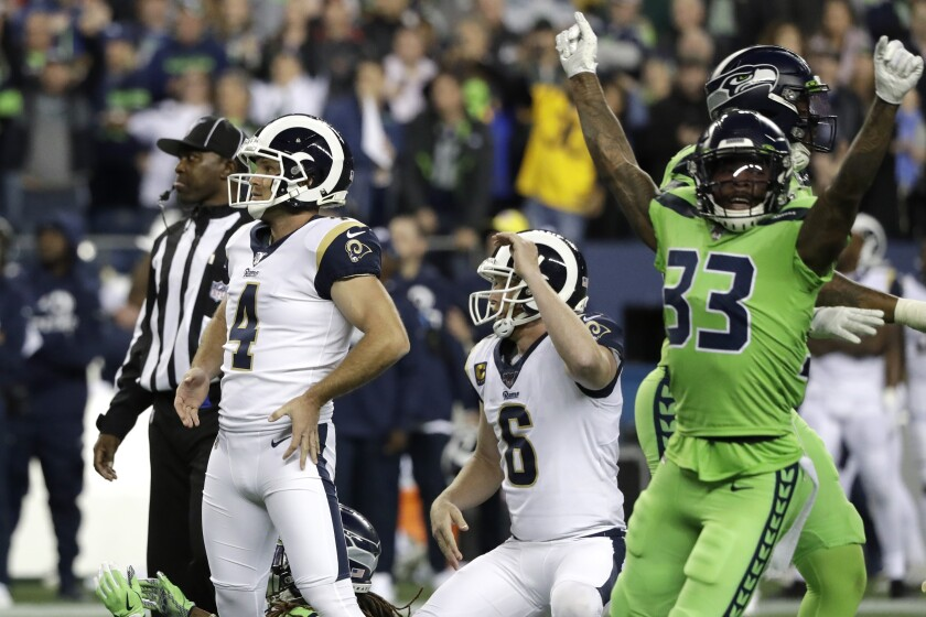 Rams kicker Greg Zuerlein, left, and Seattle Seahawks free safety Tedric Thompson react after Zuerlein missed a 44-yard field-goal attempt.