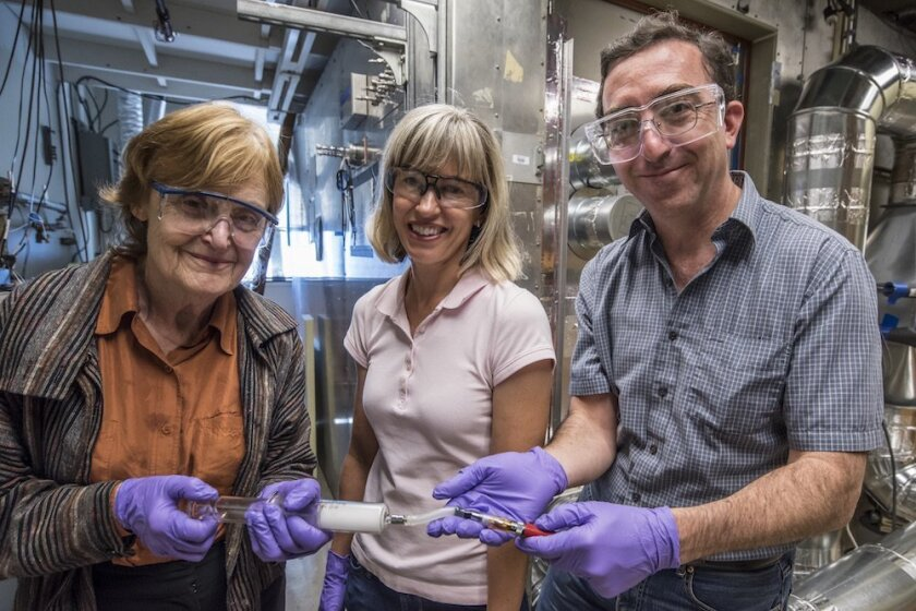 Berkeley Lab researchers (from left) Lara Gundel, Marion Russell, Hugo Destaillats demonstrate filling a glass syringe with vapor from an e-cigarette.