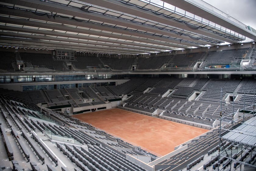 FILE - In this Feb. 5, 2020, file photo, construction work of the newly built roof of the Philippe Chatrier center court is pictured at Roland Garros stadium in Paris. The French Open has been postponed because of the conoravirus. The French Tennis Federation announced Tuesday, March 17, 2020, that the clay-court event will run from Sept. 20 to Oct. 4. Main draw competition was supposed to start on May 24. (Martin Bureau/Pool via AP, File)