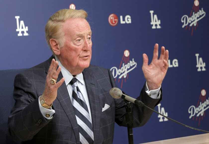 Dodgers broadcaster Vin Scully, shown at a news conference in February, recently nixed the idea of naming a street near Dodger Stadium after him.