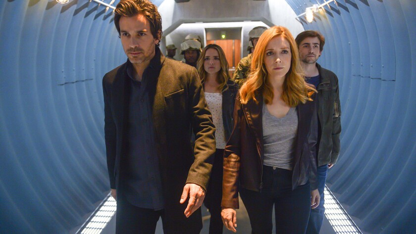 "Santiago Cabrera, left, Jacqueline Byers, Jennifer Finnigan and Charlie Rowe in the season finale of ""Salvation"" on CBS."