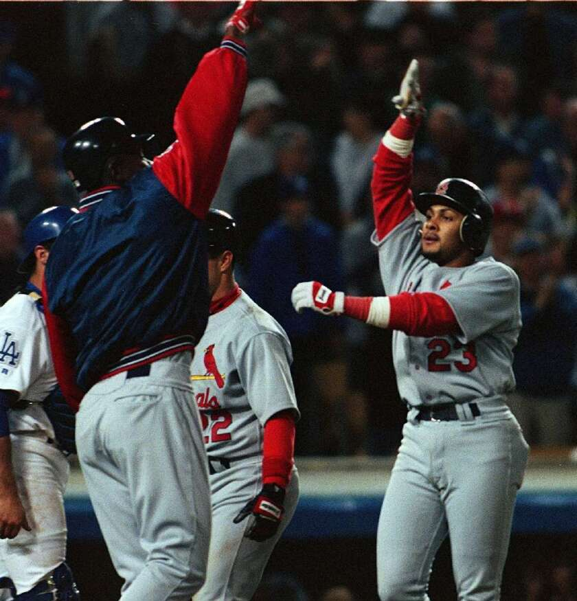 St. Louis Cardinals' Fernando Tatis, right, is greeted at home plate after hitting his second grand slam in the same inning off of DodgerS pitcher Chan Ho Park on April 23, 1999, at Dodger Stadium.