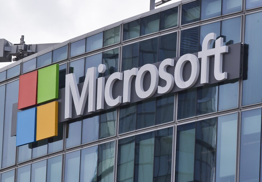 """FILE - This April 12, 2016 file photo shows the Microsoft logo in Issy-les-Moulineaux, outside Paris, France. Microsoft took five hours to resolve a major outage of its workplace applications on Monday, but has not clarified what caused the outage. The company said the outage, which affected users' ability to log into Office 365 applications, began early evening Monday Eastern time. Microsoft did not reply to questions Tuesday, Sept. 29, 2020 about what caused the outage, but said on its service-status Twitter account that it had identified a """"recent change"""" that caused problems. (AP Photo/Michel Euler, File)"""
