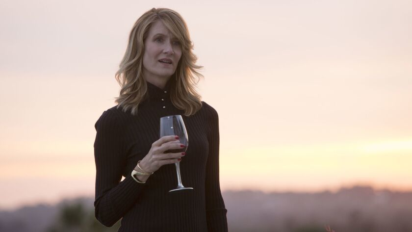 "Laura Dern, holding a glass of red wine, as Renata Klein in HBO's ""Big Little Lies."""