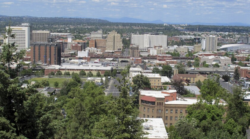 In this photo taken June 4, 2018, the downtown skyline is shown from the South Hill in Spokane, Wash