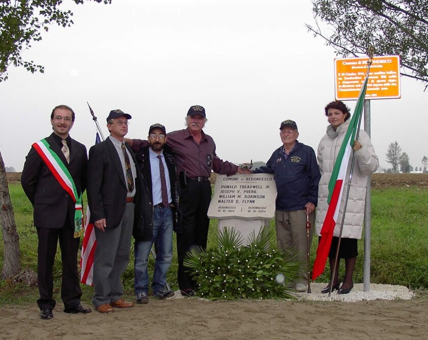 Claudio Mischi, second from left, poses in 2004 with American WWII veterans  in Italy.