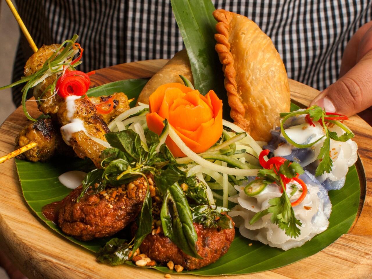 Jan ruam mit, Galangal's Thai platter, features Thai fish cake, Thai curry puff, Thai chicken satay, Chor mung flower dumplings.