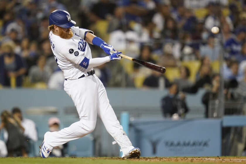 Los Angeles Dodgers' Justin Turner hits a home run during the fourth inning of a baseball game against the San Diego Padres Thursday, Sept. 30, 2021, in Los Angeles. (AP Photo/Ashley Landis)