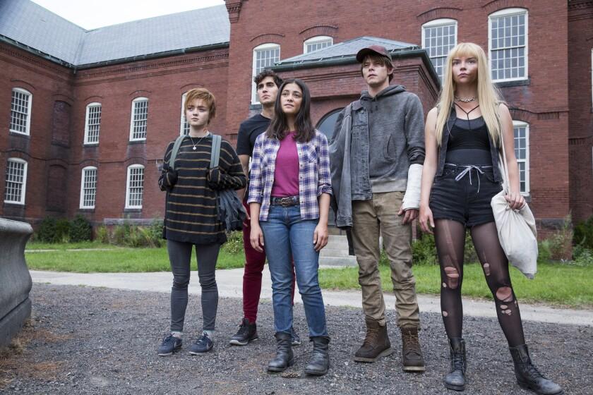"Maisie Williams, left, Henry Zaga, Blu Hunt, Charlie Heaton and Anya Taylor-Joy in ""The New Mutants."""