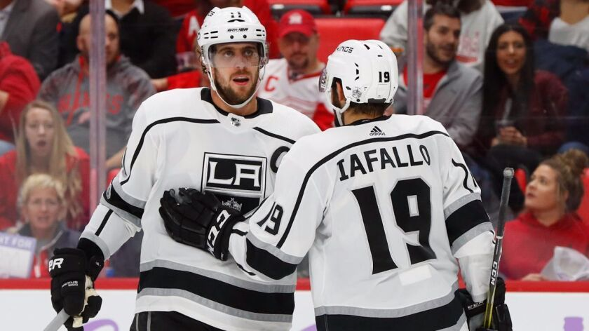 Los Angeles Kings center Anze Kopitar (11) celebrates his goal against the Detroit Red Wings with Al