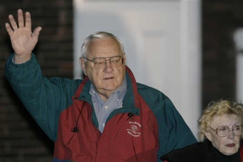 FILE - In this Nov. 7, 2007 file photo, former Illinois Gov. George Ryan leaves his home with his wife, Lura Lynn, in Kankakee, Ill., as he prepares to head to the federal correctional center in Oxford, Wis., to serve his sentence for his April 2006 conviction on racketeering and fraud charges. Rya