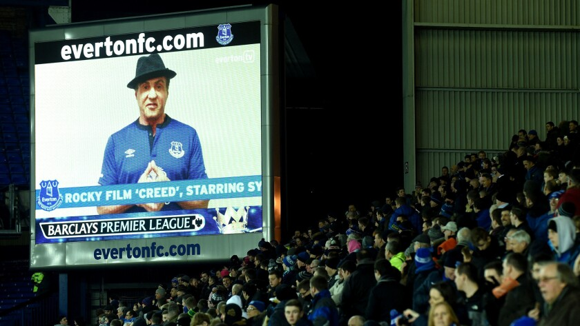"""Sylvester Stallone appears on the big screen wearing an Everton shirt at halftime of game at Goodison Park in Liverpool. Stallone asked fans to stay in their seats so they could shoot a scene for the movie """"Creed."""""""
