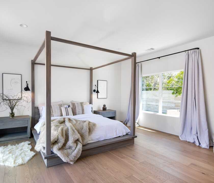 The master bedroom gets a lot of natural light from the large window to the side yard.