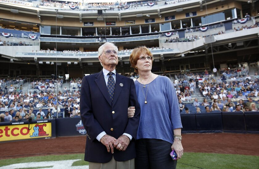 Jerry Coleman, standing with wife Maggie Coleman watch a tribute to him posted on the big screen at Petco Park.