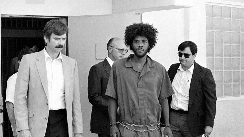Kevin Cooper, center, is seen on July 31, 1983. Cooper, who was convicted of killing four people in Chino Hills, is asking Gov. Jerry Brown for clemency and to order a new DNA review.