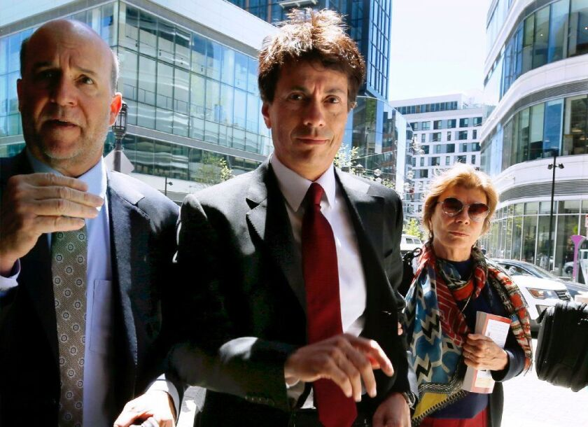 Agustin Huneeus Jr., center, appears at federal court in Boston in May, when he pleaded guilty to charges in a nationwide college admissions scandal.