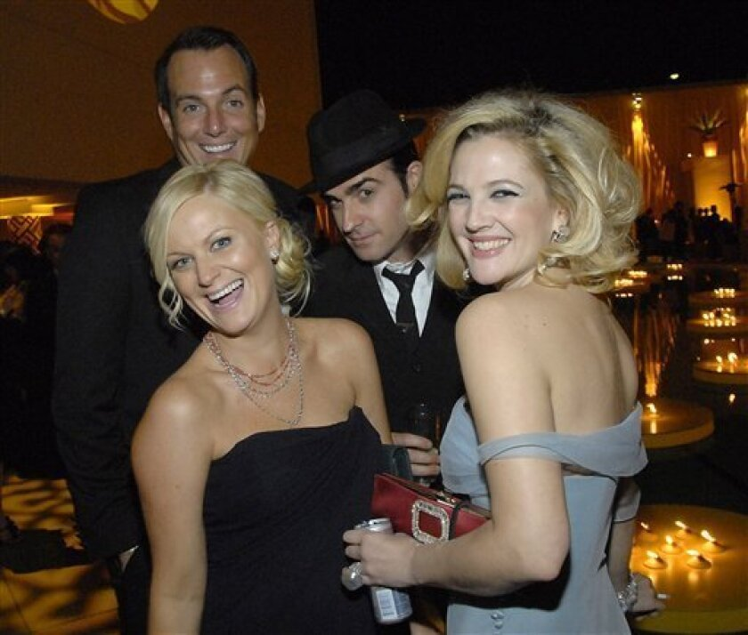 From left to right, actress Amy Poehler, actor Will Arnett, an unidentified man, and actress Drew Barrymore at the HBO Golden Globes after-party on Sunday, Jan. 11, 2009, in Beverly Hills, Calif., U.S.A.  (AP Photo/Dan Steinberg)