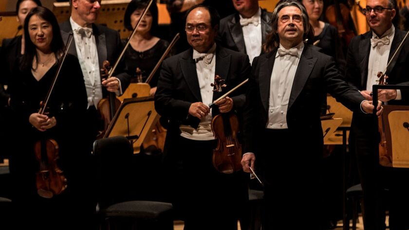 SANTA ANA, CA - OCTOBER 16, 2017: Italian conductor Italian Muti, right, acknowledges the crowd aft