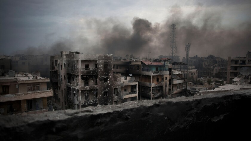 """Smoke rises over Aleppo, Syria, in 2012. Asked what he would do, if elected, """"about Aleppo,"""" presidential candidate Gary Johnson responded: """"What is Aleppo?"""""""