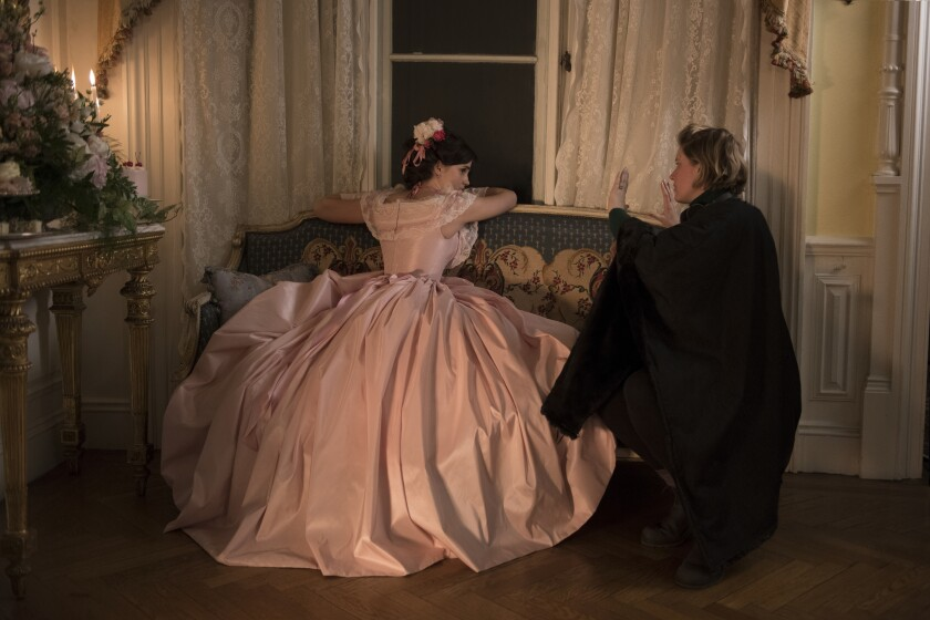 "Emma Watson and writer-director Greta Gerwig on the set of ""Little Women"""