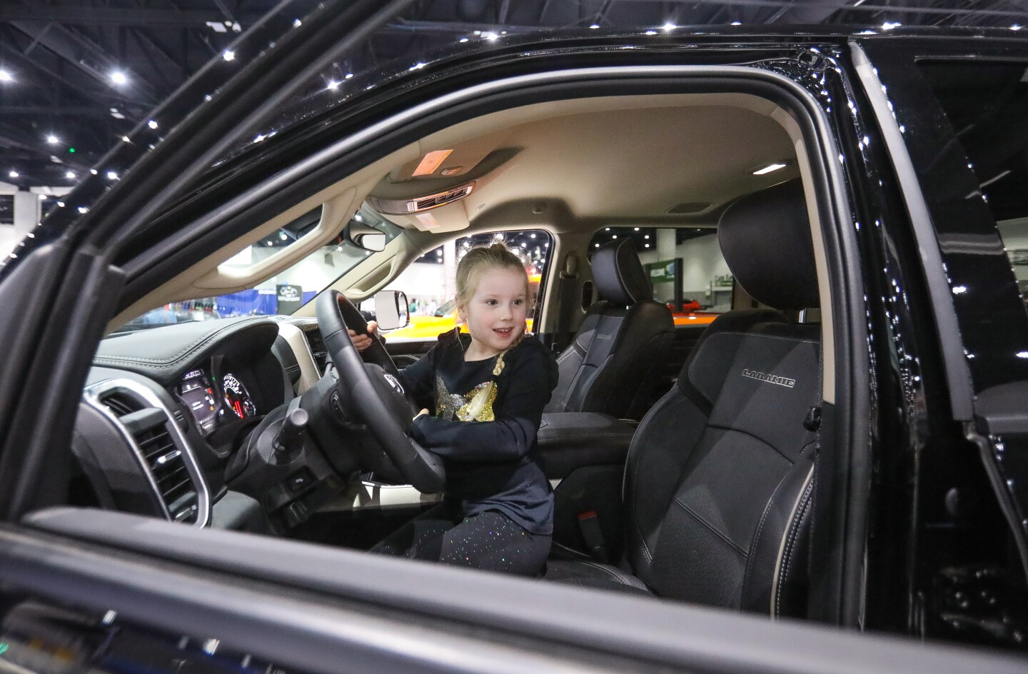Brenley Trimpi, 5, from El Cajon, sits in the drivers seat of a 2020 Ram 1500 Bighorn Crew Cab 4x4 pickup truck during the 2020 San Diego International Auto Show, January 4, 2020 at the San Diego Convention Center.