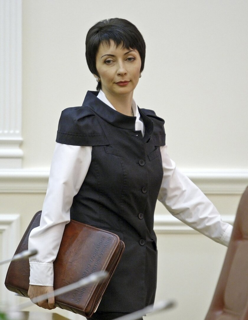 In this photo made in August 2013, former Justice Minister Olena Lukash at a cabinet meting in Kiev, Ukraine. Ukraine's Security Service says former Justice Minister Olena Lukash has been detained in connection with a probe into deadly shootings during opposition protests in 2014. (AP Photo/Volodym