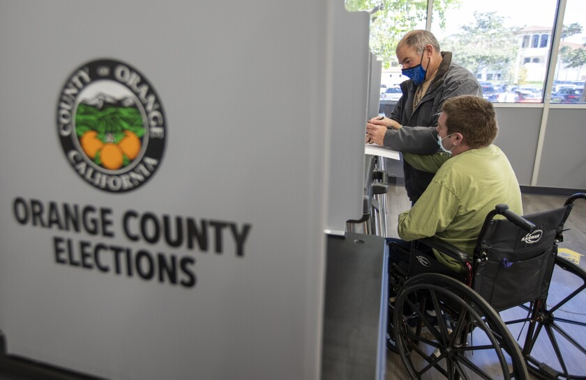 Burgess Norminton and his son Cole vote in a special election Tuesday at Costa Mesa City Hall