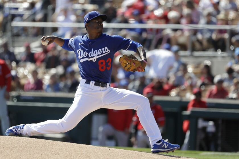 Dodgers starting pitcher Josiah Gray delivers a pitch.