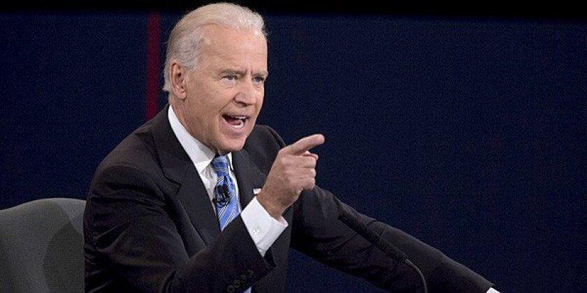 "U.S. Vice President Joseph ""Joe"" Biden gestures as he speaks during a debate with Representative Paul Ryan, Republican vice presidential candidate."