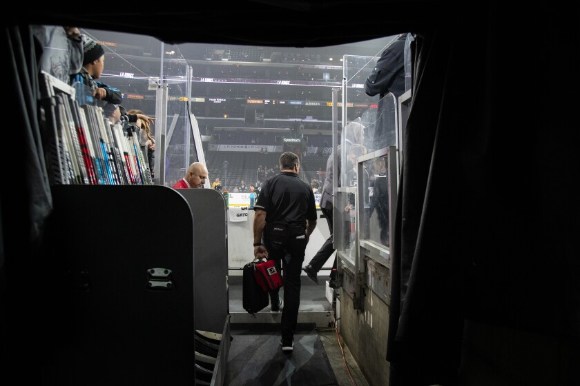 Kings trainer Chris Kingsley walks to the team bench during warmups before a game against the Edmonton Oilers at the Staples Center on Nov. 21. Kingsley is a cancer survivor.