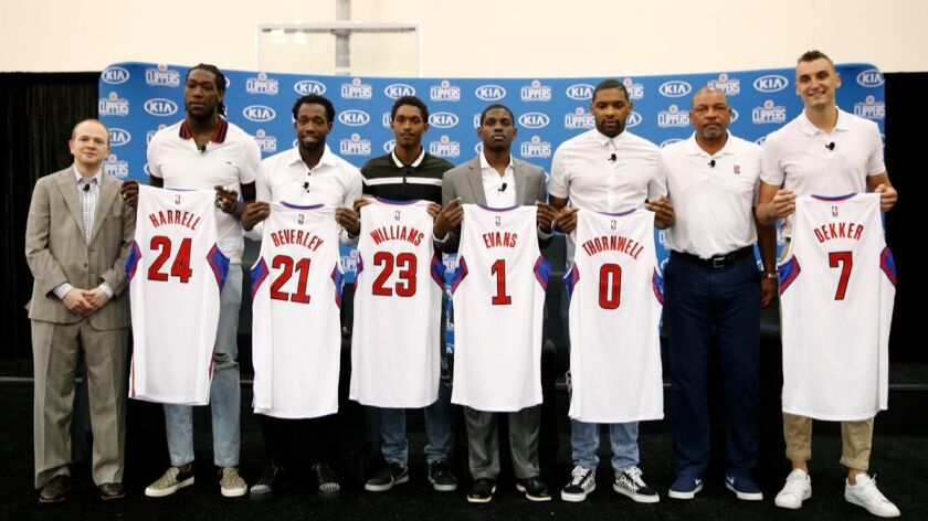 From left, Clippers executive vice president of basketball operations Lawrence Frank, Montrezl Har