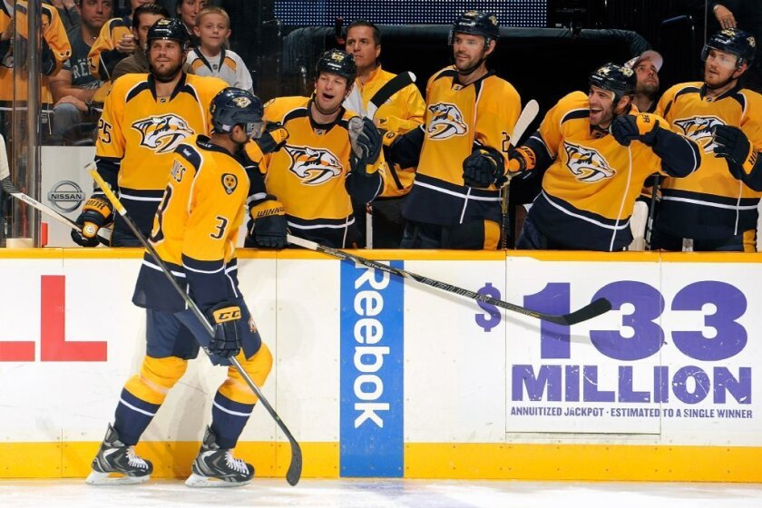 Seth Jones of the Nashville Predators is congratulated by teammates after scoring his first goal in the NHL, against the New York Islanders on Oct. 12.