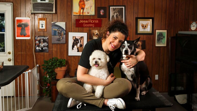 LOS ANGELES, CA-JULY 21, 2017: Dog grooming artist Jess Rona, is photographed with her two dogs, Me