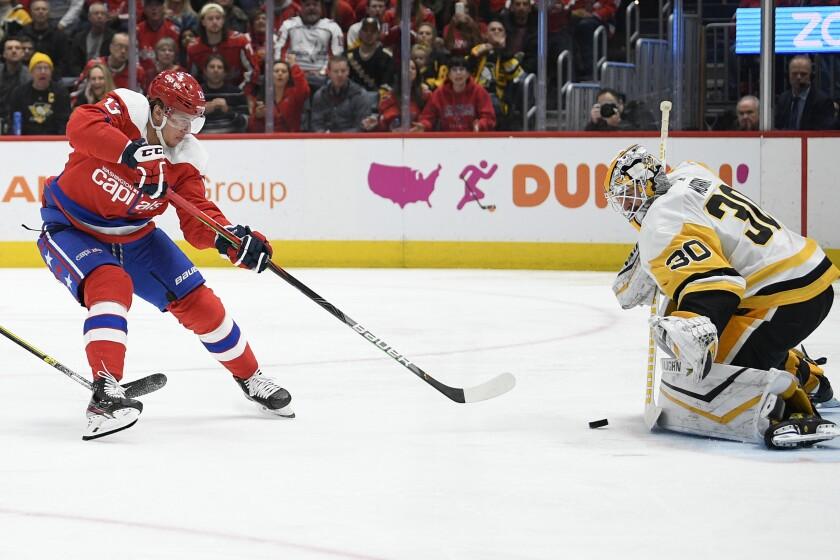 Pittsburgh Penguins goaltender Matt Murray (30) stops Washington Capitals left wing Jakub Vrana (13) during the second period of an NHL hockey game, Sunday, Feb. 2, 2020, in Washington. (AP Photo/Nick Wass)