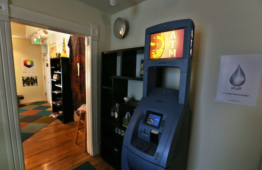 An ATM is positioned inside a marijuana store, in Boulder, Colo. Colorado state lawmakers this year are poised to pass a law clarifying that public benefit cards can't be used at pot dispensary ATMs. A bill facing its first hearing next week in the state Senate would add marijuana businesses and strip clubs to the list of Colorado businesses where public benefits cards - called EBTs - can't be used to withdraw cash.
