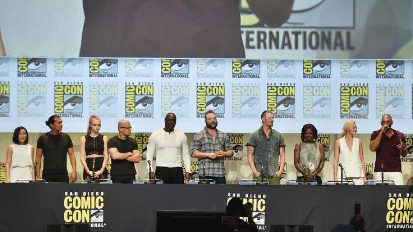 (L-R) Actors Karen Fukuhara, Adam Beach, Cara Delevingne, Jay Hernandez, Adewale Akinnuoye-Agbaje, Jai Courtney, Joel Kinnaman, Viola Davis, Margot Robbie, and Will Smith attend the Warner Bros. 'Suicide Squad' presentation during Comic-Con International 2015 at the San Diego Convention Center on July 11, 2015 in San Diego, California. (Kevin Winter / Getty Images)