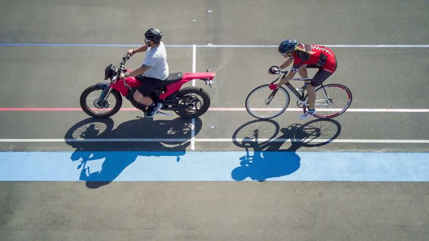 Training at the San Diego Velodrome for her attempt at the Men's Paced Bicycle Land Speed Record, Denise Mueller-Korenek paced behind cycling coach Matt Hoffmann during a recent training workout at the San Diego Velodrome.
