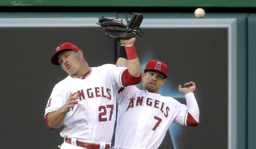Angels center fielder Mike Trout (27) and right fielder Collin Cowgill (7) collide while trying to catch a fly ball hit by Yankees shortstop Derek Jeter in the first inning Wednesday night in Anaheim.