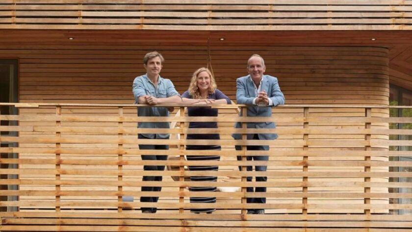 "Host Kevin McCloud, right, with a pair of homeowners in a recent episode of ""Grand Designs,"" now available on Netflix."