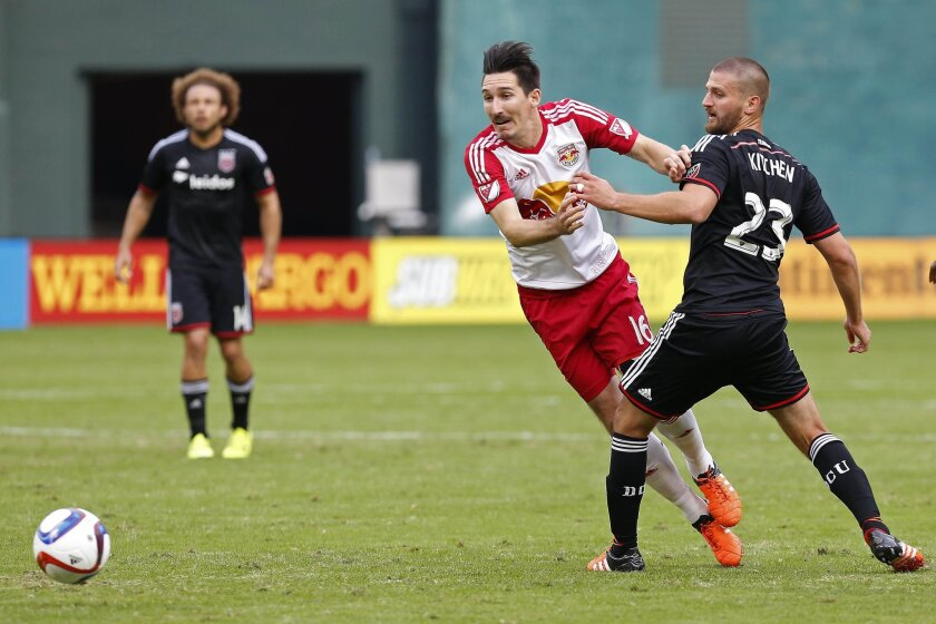 Nov 1, 2015; Washington, DC, USA; New York Red Bulls midfielder Sacha Kljestan (16) and D.C. United midfielder/defender Perry Kitchen (23) battle for the ball in the first half of the first leg of the eastern conference semi-final at Robert F. Kennedy Memorial Stadium. The Red Bulls won 1-0. Mandatory Credit: Geoff Burke-USA TODAY Sports ** Usable by SD ONLY **