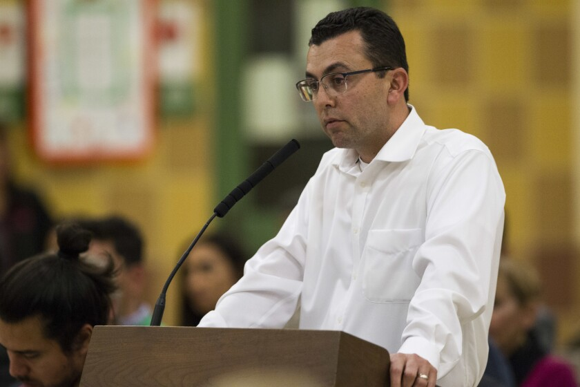 Art Castañares, chief executive of Manzana Energy, speaks to San Ysidro School District trustees at the Feb. 9 board meeting. The district and Castañares have been at odds over completion of a solar power project paid for with Proposition C bond funds.