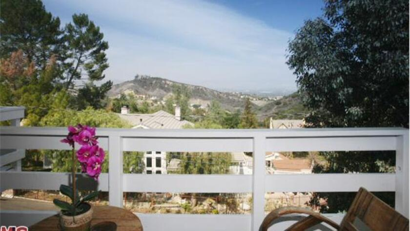Multiple terraces off the Calabasas rental home take in canyon, mountain and valley views.